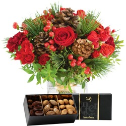 Bouquet of red flowers and box of chocolate almonds